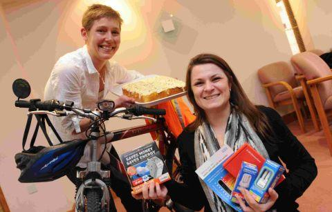 Magna project officer Jenni Edwards, right, with a selection of energy saving items and Sam Speight from Rural Foods who's promoting reducing food carbon miles