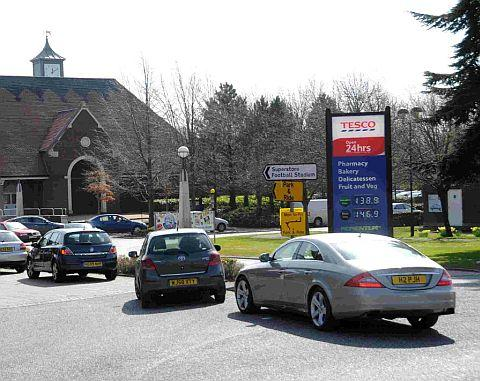 Cars queuing on Weymouth Avenue, Dorchester to fill up at the Tesco petrol station
