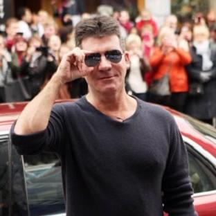 Simon Cowell is reportedly giving his ex-fiancee a house because he was a bad boyfriend