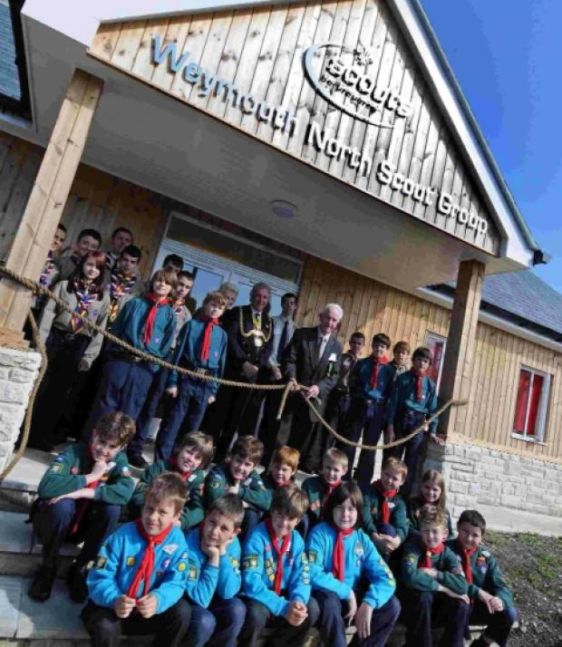 Group chairman David Meech, Mayor Graham Winter and youngsters at the opening of Weymouth North Scout Group's new base in Radipole