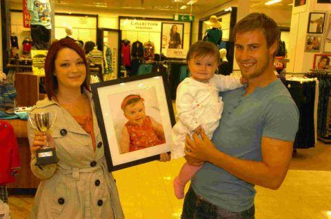 BUNDLE OF JOY: Last year's 0-9-month category and overall winner Josie Philbrick with mum Hannah Hughes and dad Chris Philbrick	Picture: GRAHAM HUNT/HG8532