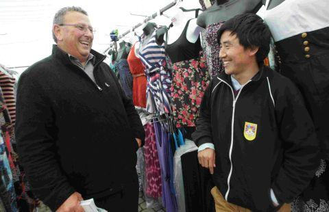 Market Manager Rod Wilson chats to Damchoe Samye at Boscombe market