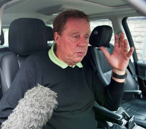 SPURS DEPARTURE: Harry Redknapp talks to the media outside his Sandbanks home yesterday