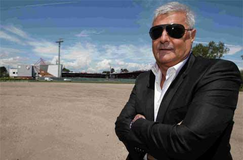 PLANS: AFC Bournemouth chairman Eddie Mitchell in the gravel car park next to the stadium at Kings Park in Bournemouth. Picture: Corin Messer