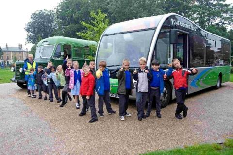 Children from Damers First School at the launch of Dorchester's first electric bus service