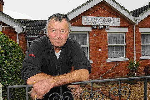 SHINING EXAMPLE: Allan Legg with the sign at his house in Weymouth