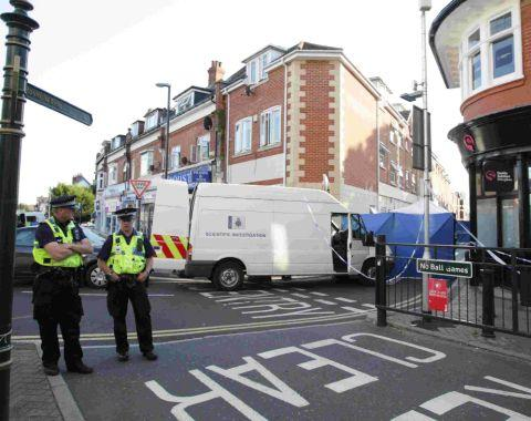 BIG OPERATION: Police at the scene of the murder in Roumelia Lane, Boscombe