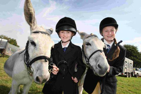 SO MUCH FUN: Sisters Katie, eight, and Amelia Ealson, 13 with their donkeys Pebbles and Princess