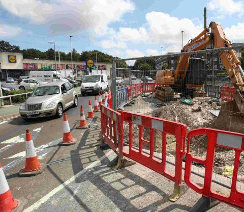 Traffic queues build up in Blandford Road, Hamworthy as emergency road works take place at the junction of Turlin Road