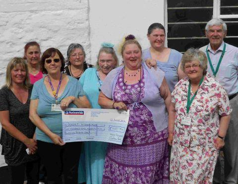 DOING THEIR BIT: Stephanie Vincent takes receipt of a cheque from Hazel Richards for the Dorset Kidney Fund