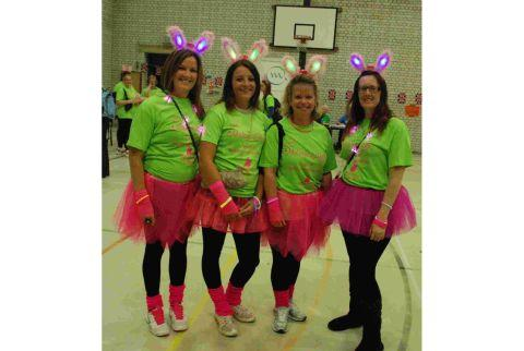 Participants dressed in their fluorescent skirts look tutu good