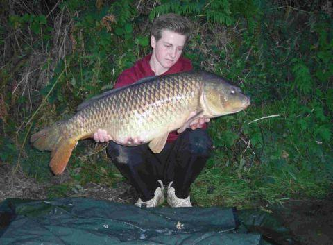 THE ONE THAT DIDN'T GET AWAY: Hugh Foley, 16, with a 26lb 14oz common carp caught in the River Frome.