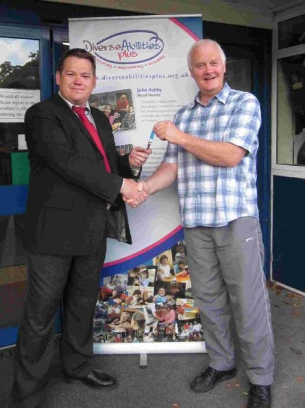 MAN IN CHARGE: New principal, Jonathan Seaward and the man handing over the reigns, John Ashby