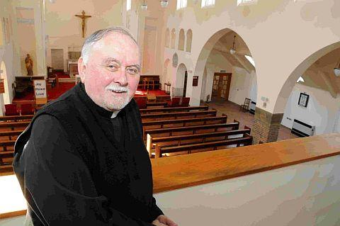 COME ON IN: Father Stephen Geddes at the newly enlarged St Joseph's Church