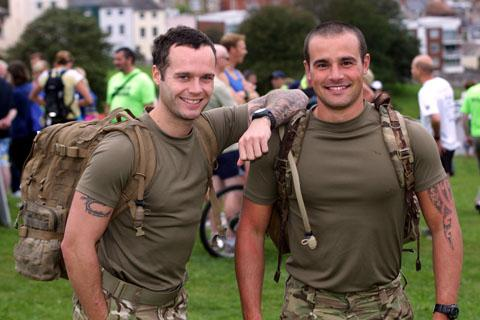 ATTENTION!: Pt Darren Lyons and, right, Pt Barry King from 3 Medical Regiment who were 'Tabbing' the route with full packs