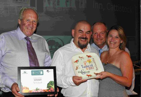 CHEERS: The Fox and Hounds at Cattistock wins the Best Local award, presented by Mat Follas