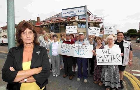 FLATS: Cllr Carol Ainge, front, is joined by local residents on Malmesbury Park Road where they are protesting against plans to remove a restriction on a block of flats.