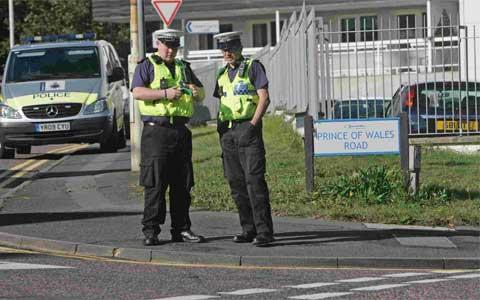 CRASH SITE: Accident investigation officers at the scene of the collision at the junction of Princess Road and Prince of Wales Road in Westbourne