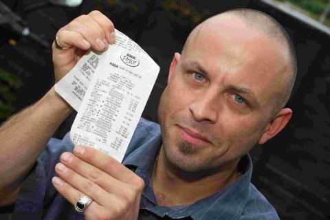 Nathan Cole with his mother's receipt for the Asda Pork chops