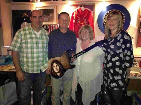 WHAT A LOT: Lucy Campbell, right, with a handmade ornamental guitar donated and signed by Deep Purple's Ian Gillan