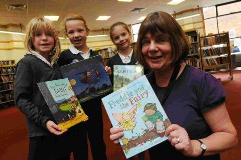 READ ALL ABOUT IT: Childrens lauraete Julia Donaldson at Weymouth Library with Holy TrinityDaisy Hope, Kaitlyn Knight and Harriet Mabey