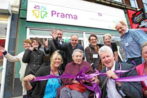 SNIP: Prama client Jean Foulger cuts the ribbon to officially open the new Prama charity shop in Ashley Road, Parkstone with Chief Executive Jeff Russell and staff and volunteers