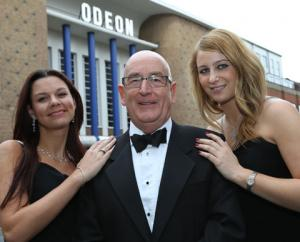 SMITH, STAN SMITH: Flanked by 'Bond girls' Amy Dorgan and Kate Paszkowec at the Odeon.