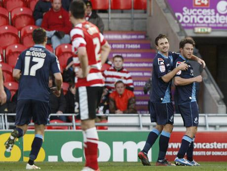 WINNER: Marc Pugh congratulates Harry Arter on his goal against Doncaster