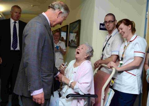 DELIGHTED: Prince Charles meets a patient during his visit to Dorset County Hospital
