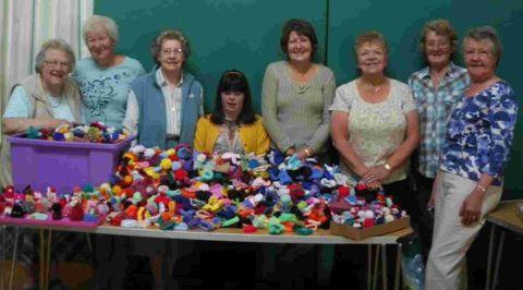 HATS THE WAY: Knitters in Portland with a whopping 3,081 little bobble hats