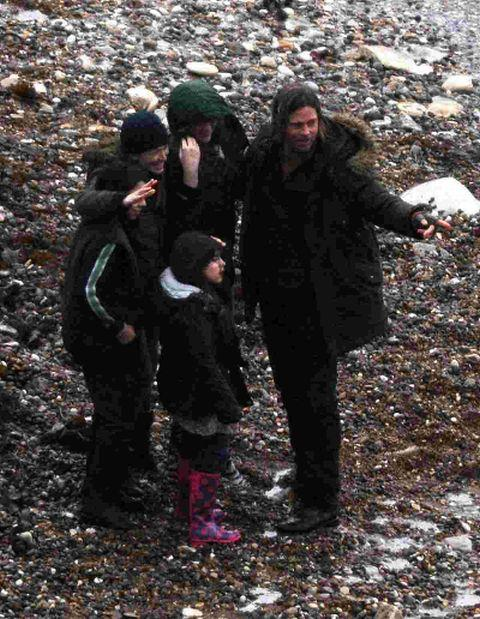 SHORE THING: Brad Pitt filming at Lulworth Cove with fellow actors