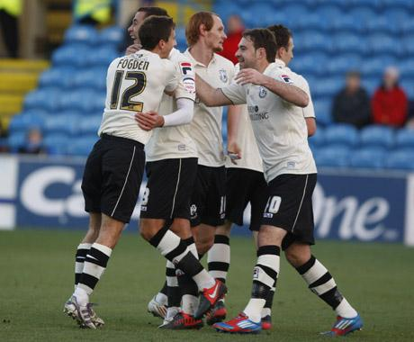 OPENER: Cherries celebrate Wes Fogden's goal at Brunton Park