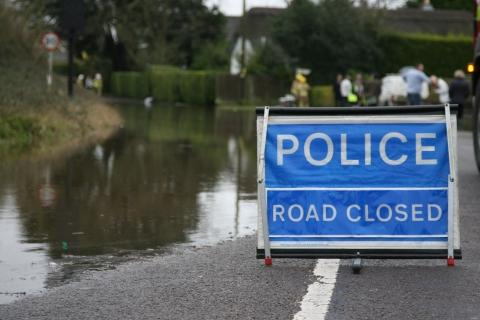 Salisbury Road in Burton is closed by emergency services following flooding across the road