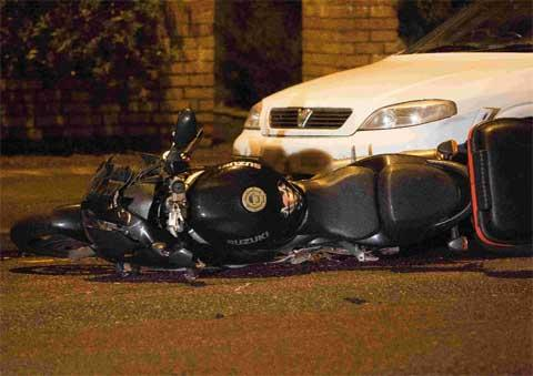 CRASH SCENE: The motorbike involved in a collision with a pedestrian on Wimborne Road