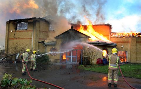 Firefighters deal with the blaze at Lytchett Minster School. Picture: Richard Crease.