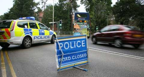 Police close Lindsay Road after the accident. Picture: Jon Beal.