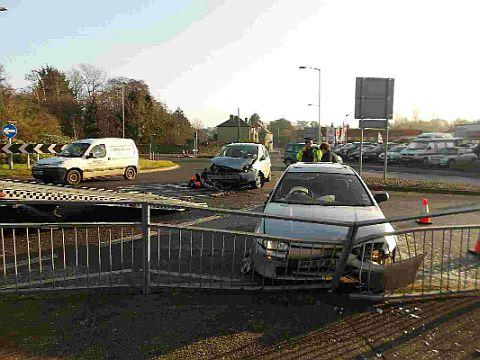 AFTERMATH: A silver Mazda 323 and a silver Ford Focus after the collision