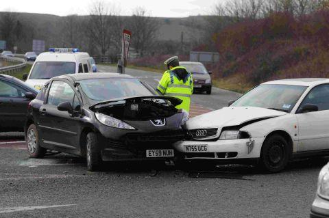 AFTERMATH: A police officer at the scene of crash at Miles Cross, Bridport, in which a man suffered chest injuries