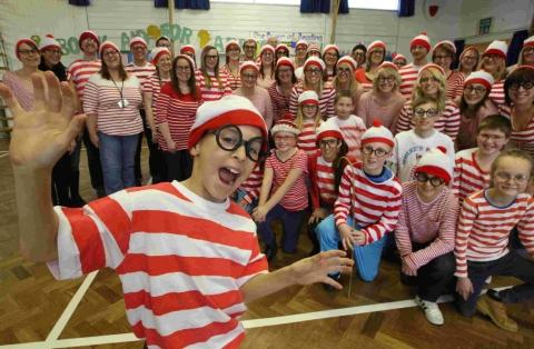 STRIPY STAR: Year four pupil Joshua Carroll, 9, and staff and pupils at Talbot Combined School who had dressed up in Where's Wally costumes as part of World Book Day