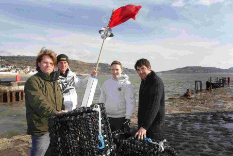 FLYING THE FLAG: Launching the Lyme Bay Experimental Potting Project at Lyme Regis are fishermen Alex Jones, David Moncraff, and Nigel Marsh, and Plymouth University PhD student Adam Rees