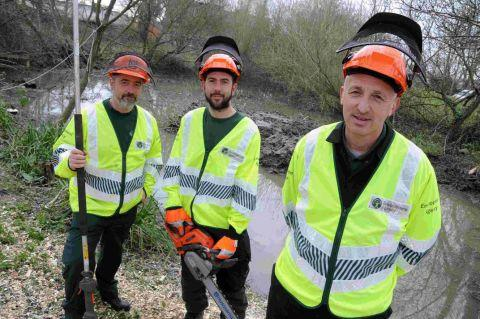 HELPING HANDS: Environment Agency workers Chris Rowland, Morgs Morgan and Barry Pitman at Allington Pond