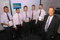 WINNING SMILES: Ulra Electronics managing director Ray Coles, right, with Jonathon Williams, Ian Sim, Andy Pass, Andy Matko and Andy Loveless